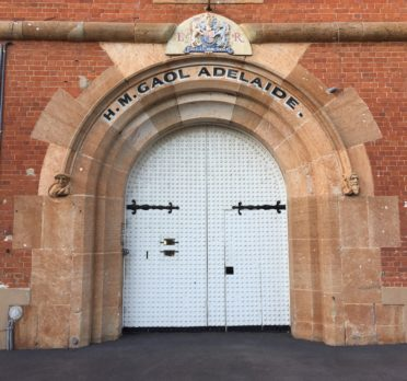Image: large arched door sent in brick wall