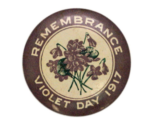 Image: purple badge with image of violets