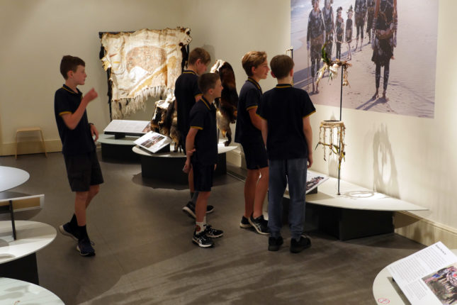 Group of school children in a museum gallery