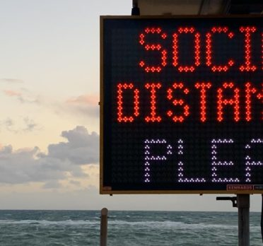 Social distancing sign at the beach