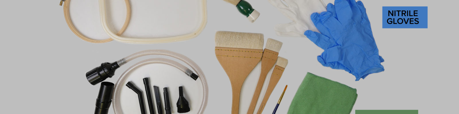 Selection of cleaning tools layed out on a table.