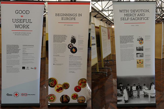 Three pull up banners showing text and images related to Red Cross.