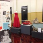 Display of items including a red dress