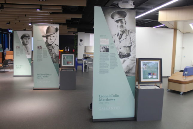 Series of banners in light teal and showing black and white photos.