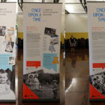 Collage of three banners showing text and images in a large hall.