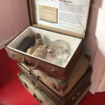 Stack of suitcases showing items salvaged from a shipwreck on display